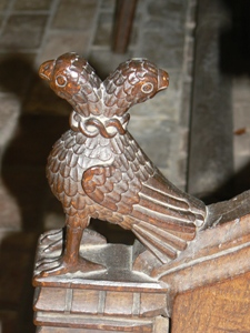 Carving of two headed eagle on arm rest