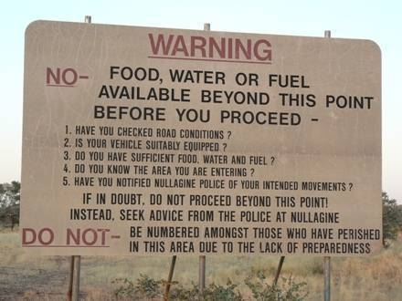 Warning sign on the way to Nullagine that no food, water or fuel is available past that point
