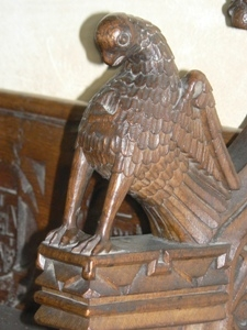 Arm rest carving. Bird - eagle?