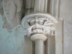 Carving of a Green Man in the south chancel window